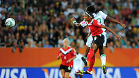 Candace Chapman (l) of team Canada and Desire Oparanozie of team Nigeria during the FIFA Women's World Cup at the FIFA Stadium in Dresden, Germany on July 5th, 2011.