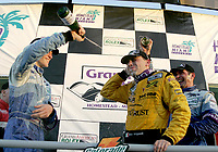 Jorg Bergmeister and Max papis spray champagne on Max Angelelli after the Grand Prix od Miami at Homestead-Miami Speedway on Saturday, March 5, 2005.(Grand American Road Racing Photo by Brian Cleary)