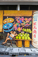 Ipoh, Malaysia.  Wall Painting, Fruit Vendor at Rest.