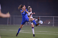 Gwen Duijsters (13) of KRC Genk tries to block the shot of Michelle Colson (2) of Anderlecht in action  during a female soccer game between  Racing Genk Ladies and Royal Sporting Club Anderlecht , a delayed game from the 1st  matchday of the 2021-2022 season of the Belgian Scooore Womens Super League , tuesday 28 September 2021  in Genk , Belgium . PHOTO SPORTPIX | JILL DELSAUX