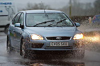 Friday 31 January 2014<br /> Pictured: A car drives through a flooded Penblewin Roundabout near Nartbeth, West Wales<br /> Re: Severe weather warnings are issued accross Wales and England