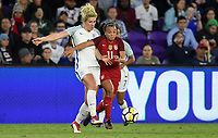 Orlando City, FL - Wednesday March 07, 2018: Millie Bright, Mallory Pugh during a 2018 SheBelieves Cup match between the women's national teams of the United States (USA) and England (ENG) at Orlando City Stadium.