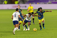 ORLANDO, FL - JANUARY 22: Catarina Macario #29 fights off Jéssica Caro #8 and Daniela Arias #3 to keep possession during a game between Colombia and USWNT at Exploria stadium on January 22, 2021 in Orlando, Florida.
