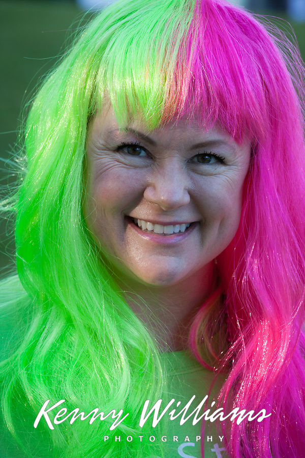 Woman wearing pink and green wig, Seattle Center, WA, USA.