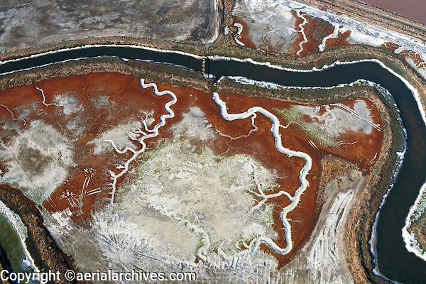 aerial above salt crystallizer following ancient tidal channels San Francisco bay