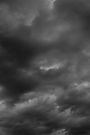 Stratocumulus clouds dark and foreboding toward late evening.