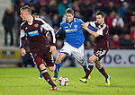 Hearts v St Johnstone....02.11.13     SPFL<br /> David Wotherspoon fends off Jason Holt<br /> Picture by Graeme Hart.<br /> Copyright Perthshire Picture Agency<br /> Tel: 01738 623350  Mobile: 07990 594431