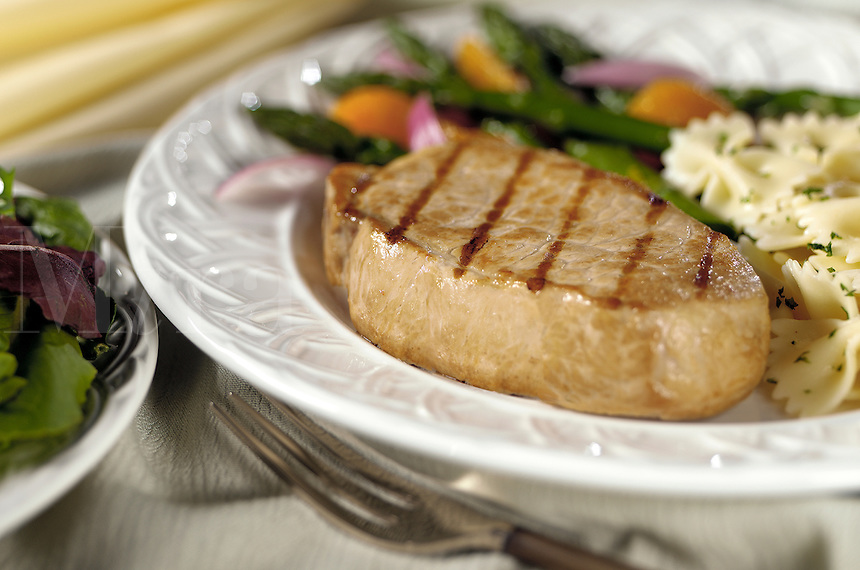 boneless porkchop on plate with asparagus