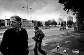 Litvinov, Czech Republic.July 1997.In an industrial city in northwest Czech Republic pollution and economic hardships dominate the landscape. Unemployed construction workers pass the morning hours drinking at the train station..