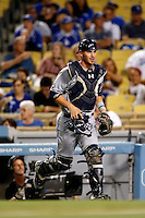 Yasmani Grandal #12 of the San Diego Padres during a game against the Los Angeles Dodgers at Dodger Stadium on September 5, 2012 in Los Angeles, California. San Diego defeated Los Angeles 4-3. (Larry Goren/Four Seam Images)