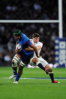 Thierry Dusautoir of France is tackled by Ben Youngs of England