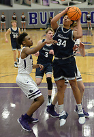 Bentonville West's Jacob McGhee (34) takes a shot in the lane Tuesday, Jan. 5, 2021, as he is guarded by Fayetteville's CJ Williams (left) during the first half of play in Bulldog Arena in Fayetteville. Visit nwaonline.com/210106Daily/ for today's photo gallery. <br /> (NWA Democrat-Gazette/Andy Shupe)