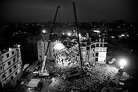 Rescue workers attempt to rescue garment workers from the rubble of the collapsed Rana Plaza building, in Savar, near Dhaka,  Bangladesh