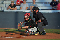 Concord A's catcher Justin Stewart (9) (California University of Pennsylvania) sets a target as home plate umpire Britton Kennerly looks on during the game against the Mooresville Spinners at Moor Park on July 31, 2020 in Mooresville, NC. The Spinners defeated the Athletics 6-3 in a game called after 6 innings due to rain. (Brian Westerholt/Four Seam Images)
