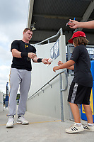 FCL Pirates Black Henry Davis (32) signs autographs before a game against the FCL Rays on August 3, 2021 at Charlotte Sports Park in Port Charlotte, Florida.  Davis was making his professional debut after being selected first overall in the MLB Draft out of Louisville by the Pittsburgh Pirates.  (Mike Janes/Four Seam Images)