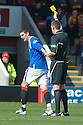 RANGERS' KYLE LAFFERTY TRIES TO SWEET TALK REFEREE CRAIG THOMSON INTO NOT SHOWING HIM A YELLOW CARD... BUT IT DOESN'T WORK