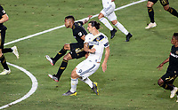 CARSON, CA - JULY 19: Zlatan Ibrahimovic #9 of the Los Angeles Galaxy takes a shot on goal during a game between Los Angeles FC and Los Angeles Galaxy at Dignity Health Sports Park on July 19, 2019 in Carson, California.