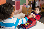Preschool 3-4 year olds boy and girl playing store play money handed to the customer, counting the money