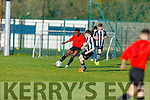 Park FC's Mervin Shalemba tries to get around Bradley Walsh of St Marys of Cork in the FAI Youths Cup game in Christy Leahy Park on Sunday.