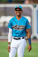 Grand Rapids Dam Breakers second baseman Jose King (4) during warmups before a game against the Fort Wayne TinCaps on August 21, 2021 at LMCU Ballpark in Comstock Park, Michigan.  The West Michigan Whitecaps rebranded for the day as the Grand Rapids Dam Breakers to bring awareness to the Grand River Restoration Project. (Mike Janes/Four Seam Images)