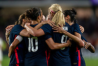 ORLANDO, FL - MARCH 05: Carli Lloyd #10 and Tobin Heath #17 of the United States celebrate with Lindsey Horan #9 during a game between England and USWNT at Exploria Stadium on March 05, 2020 in Orlando, Florida.