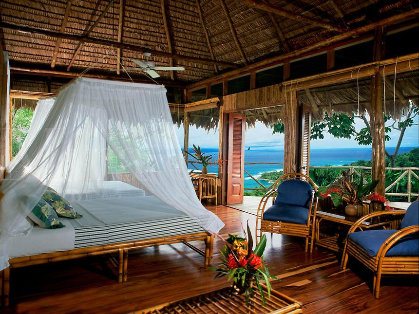 Tropical bedroom with ocean view.
