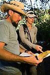 North American Cougar (Puma concolor couguar) biologists, Zachary Dautrich and Jen Joynt, checking camera traps, Tilden Regional Park, Berkeley, Bay Area, California