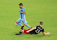 WASHINGTON, DC - SEPTEMBER 06: Maximiliano Moralez #10 of New York City FC dribbles past Frederic Billant during a game between New York City FC and D.C. United at Audi Field on September 06, 2020 in Washington, DC.
