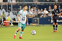 KANSAS CITY, KS - AUGUST 10: Santiago Colombatto #22 Club Leon with the ball during a game between Club Leon and Sporting Kansas City at Children's Mercy Park on August 10, 2021 in Kansas City, Kansas.