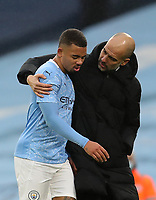 10th January 2021; Etihad Stadium, Manchester, Lancashire, England; English FA Cup Football, Manchester City versus Birmingham City; Manchester City manager Pep Guardiola puts his arm around Gabriel Jesus of Manchester City as he is subsituted