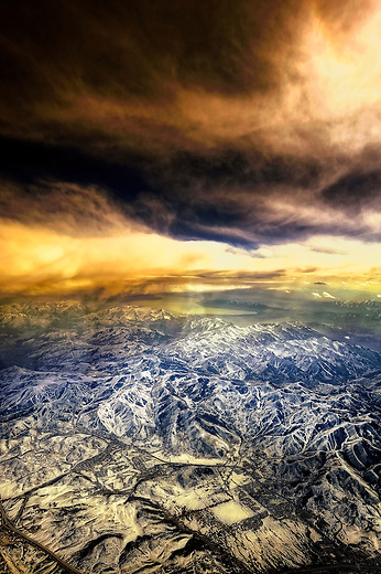 Aerial sunset over the snow capped Rockies of Colorado