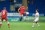 Euro 2012 Qualifying match - Wales v Montenegro at the Cardiff City Stadium..Wales Neil Taylor controls the ball in the air..