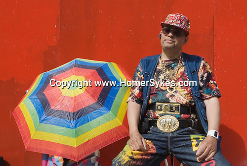Male fashion victim wearing Bling jewelry Brick Lane Market Shoreditch  London UK