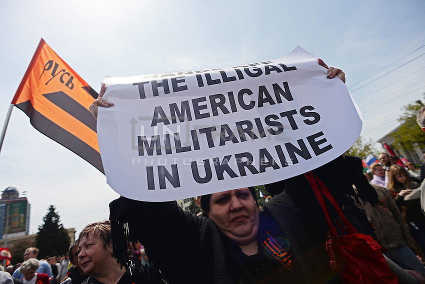 A Pro-Russian demonstrator shows a banner in Donetsk during the celebration of  the Victory Day, the Soviet holiday commemorating the defeat of the Nazis.  Sunday is May 11, the proposed date for the separatists' referendum on greater autonomy for eastern Ukraine.