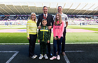 Lee Trundle with Swansea Academy Youth Player prior to kick off of the Premier League match between Swansea City and Stoke City at The Liberty Stadium, Swansea, Wales, UK. Saturday 22 April 2017