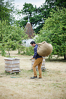 Troy Scott Smith using hessian to carry things around the garden
