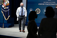 Dr. Anthony Fauci is seen before President Joe Biden participates in an event commemorating the 50 million COVID-19 vaccine shot during a ceremony at the White House, Thursday, Feb. 25, 2021.   Ms. Bussey lives in Southeast DC. Ms. Bussey has been working ever since the pandemic. <br /> Credit: Doug Mills / Pool via CNP /MediaPunch