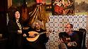 Lisbon, Portugal. 05.05.2015. Filipa Tavares, Fadista, sings at restaurant Coracao de Alfama, accompanied by Mucio Sa, on Portuguese Guitar and Paulo Santos, on Classical Guitar. Photograph © Jane Hobson.