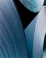 August 30, 1998, Laval, Quebec, Canada<br /> <br /> Rolls of steel are stored, at Alliance Steel warehouse in Laval, Canada.  before beeing transformed into sheets of various sizes<br /> NOTE :  property released photo.<br /> <br /> THe European Union , the World Commerce Organisation as well as many countries  reacted stronly today, March 5th 2002 after the annonce by US Preseident Bush of a 30 % tax on steel importation into the US, to protect it's steel industry.<br /> only Canada, Mexico and 2 other countries are exempt from this tax<br /> <br /> Mandatory Credit: Photo by Pierre Roussel- Images Distribution. (©) Copyright by Pierre Roussel <br /> ON SPEC<br /> <br /> NOTE :  property released photo.<br /> NOTE: scan from an 8x10 print of a 2 1/4 negative ,saved in Adobe 1998 RGB.