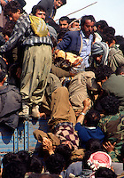 .Cukurca - Kurdistan - Turkish Iraqi border - April 1991.Consequences of Gulf War. Thousands of ethnic kurds fled Iraq becouse of fightings between Saddam Hussein and NATO troops..In the picture clashes between refugees during one delivery of food..Life conditions in the camp were very bad due to the cold and the lack of humanitarian aid..Photo Livio Senigalliesi