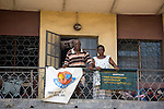 "HIV/AIDS counseling and home care services are advertised along side a ""Make We Talk"" banner in Lagos, Nigeria's most populous city.  ""Make We Talk"" is an HIV prevention project implemented by the Society for Family Health (SFH) and other partners.  SFH is Nigeria's largest indigenous non-profit and affiliate of the international social marketing organization, Population Services International (PSI)."