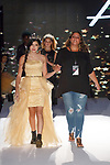 Fashion designer Melissa Ozer walks runway with models at the close of her Angora Boutique Spring Summer 2020 runway show, for The Society Fashion Week Spring Summer 2020 during New York Fashion Week, on September 7, 2019.