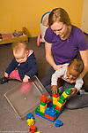 Day Care  Child Care infants female caregiver with two children