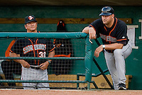 Delmarva Shorebirds pitching coach Troy Mattes #38 and manager Ryan Minor #44 watch the action from the visitors dugout at NewBridge Bank Park April 15, 2010, in Greensboro, North Carolina.  Photo by Brian Westerholt / Four Seam Images