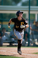 Pittsburgh Pirates third baseman Patrick Dorrian (67) runs to first base during a Florida Instructional League game against the Detroit Tigers on October 2, 2018 at the Pirate City in Bradenton, Florida.  (Mike Janes/Four Seam Images)