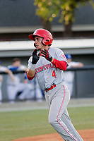 Greeneville Reds shortstop Claudio Finol (4) after scoring a run during a game against the Burlington Royals at the Burlington Athletic Complex on July 7, 2018 in Burlington, North Carolina.  Burlington defeated Greeneville 2-1. (Robert Gurganus/Four Seam Images)