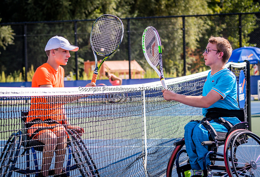 Amstelveen, Netherlands, 19 Augustus, 2020, National Tennis Center, NTC, NKR, National Junior Wheelchair Tennis Championships, Maarten ter Hofte (NED) is congratulated bij Xavier Donker (NED) (R) with his win, they dont shake hands becouse of covid-19<br /> Photo: Henk Koster/tennisimages.com