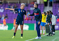 ORLANDO, FL - FEBRUARY 21: Lindsey Horan #9 of the USWNT talks to Vlatko Andonovski during a game between Brazil and USWNT at Exploria Stadium on February 21, 2021 in Orlando, Florida.