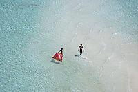 Aerial view of a couple on a beach in Palau. Micronesia