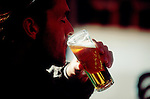 Barcelona, Spain, Young man drinking a cana, small draft beer, sidewalk cafe,.